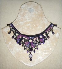Crochet necklace made from hand dyed raw silk and recycled glass beads