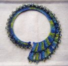 Crochet Spiral Torque made from hand dyed raw silk and recycled glass beads